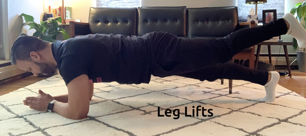 man doing leg lift plank